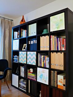 Ikea Expedit hack - canvas art swinging doors - could do this with kid art to match room.  How cute!