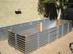 Corrugated metal wall for raised bed garden