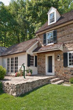 Stone, timber, white siding, shutters