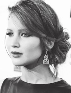 Jennifer Lawrence - Low loose bun with texture and some great earrings...sometimes all you need for a beautiful black and white picture!