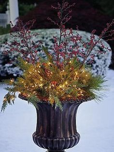 "Fill your gorgeous outdoor urns with a festive and beautiful holiday display with the 44"" Pre-lit Estate Urn Filler that features stunning sprays of crimson berries, thick greenery and glowing lights."