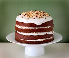 Pumpkin Spice Cake with Coconut Vanilla Icing and Roasted Hazelnuts