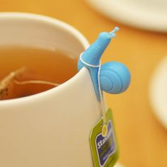 Little snail to hold my tea bag. Cute ideas and no reason it couldn't be made out of polymer clay.
