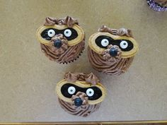 Raccoon cupcakes using buttercream icing and Nutter Butters....I love Nutter Butters!