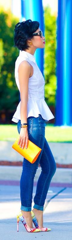 .White Top, Skinny Jeans, Multi-Colored Shoes, & Accent Color Bag.
