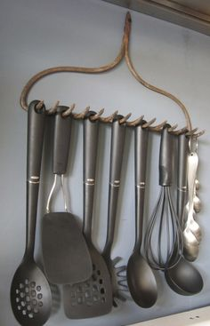 Vintage old rake upcycled into kitchen utensil rack; upcycle, recycle, salvage, diy, repurpose!  For ideas and goods shop at Estate ReSale & ReDesign, Bonita Springs, FL
