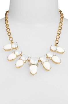 This sparkly white opal and gold necklace is so pretty. My son's birthstone is opal. must have this!
