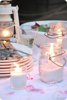jars + sand + candles = inexpensive patio decor