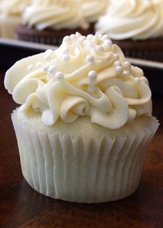 White Wedding Cupcakes with Wedding Cupcake Buttercream (easiest recipe ever, and everyone always raves how good these are!)