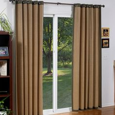 Woven Wood Grommet Panels are a unique alternative to vertical blinds for sliding glass doors. Chose these over corded window coverings for safety in spaces with small children.