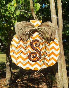 Hey, I found this really awesome Etsy listing at http://www.etsy.com/listing/163144952/customized-chevron-pumpkin-door-hanger