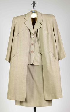"Beige wool ensemble, by Vera Maxwell, American, 1945. Maxwell states that her first ""real"" design job was with Adler & Adler, where she worked from 1936-1937 and afterwards, found contract work to be very advantageous. Her classic, comfortable and timeless designs continued to garner praise and in 1947 she opened a business under her own name, Vera Maxwell Originals. Her career outlasted that of her contemporaries, as she did not stop designing until 1985."