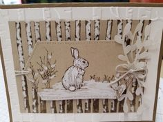 Stampin Up Nature's Beauty my version of a Snow Bunny. Winter Woods and Bunny in Soft Suede Ink on Crumb Cake. Colored with S U Chalk marker. Woodland Textures Embossed on very vanilla.Soft Suede paper card base.