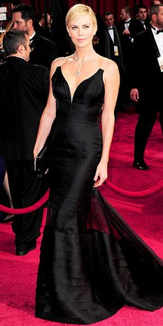 The Night's Biggest Fashion Risk-Takers | CHARLIZE THERON | Editors here have been powwowing over Charlize's Christian Dior Couture gown ever since she hit the red carpet. The gist of the huddle goes something like this: Do we love it? What's with the see-through straps? They're sort of like clear bra straps. Well, the plunge is sexy. But what about the sheer panel at the skirt? We've yet to reach a verdict.
