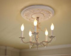 An intricate ceiling medallion and ornate chandelier evoke romance and luxury.
