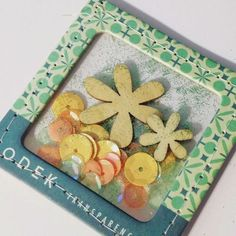 Tutorial from Annabelle O'Malley on making embellishment pockets from chipboard frames and plastic packaging