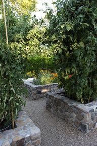 Stunning stone walled raised garden beds.