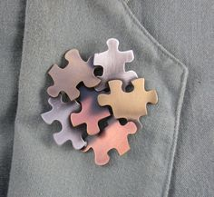 Autism Awareness Brooch by PINSwithPERSONALITY on Etsy. $18.00, via Etsy.