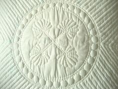 Hand quilted (Trapunto) project by STORY QUILT