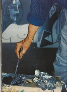 Picasso at work, paintbrush, oil paint, cuffed button-down polka-dot shirt, pinstripe overalls