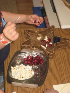 stringing garland of cranberries and popcorn