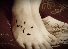 bird feet tattoo