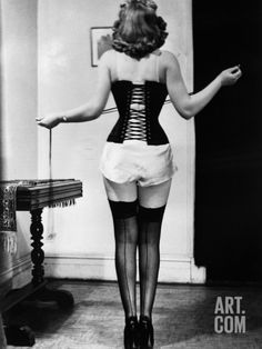 Young Woman Lacing Her Corset Photographic Print by Bettmann at Art.com