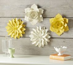 These bright blooms have a glossy finish and make a striking summer statement when hung on walls. Crafted of metal and bent by hand, they look great clustered together or spread throughout the room.