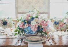 Rustic table with pink and blue flowers