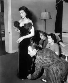 Vivien Leigh being fitted for Scarlett's red shame dress in GWTW.