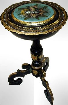 Victorian papier mache sewing stand inlaid and trimmed with abalone.  Painted shell design and gilt accents, hinged, locking top reveals original blue silk and velvet fitted interior, lift out tray and mirror