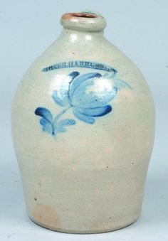 "Sold For $ 850 Moyer, Harrisburg One Gallon Stoneware Jug with spitting tulip and foliate cobalt blue decoration, bulbous form with applied handle, (William Moyer, Harrisburg, Pa., c. 1858-1860), good condition, 11"" h."