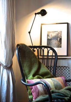 IKEA Rattan chair, Designer Guild's throw, Missoni's cushion, Jielde Lamp