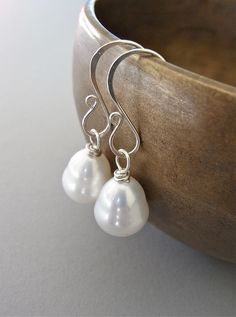 The Rococo earrings - beautiful baroque-shaped easy care south sea shell pearls are finished with my hand forged signature ear wires in sterling.