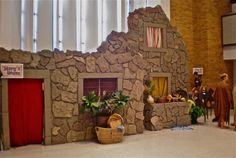 """""""Mary's House"""" facade was made out of 2 inch foam board then painted to look like stone. The company we buy the VBS curriculum from has great instructions on how to make facades out of this material."""