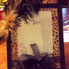 DIY dry erase board from $1 store picture frame and scrapbook paper