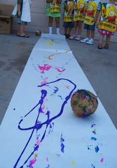 Greatest Resource Chicka Chicka Boom Boom - art - gross motor - rolling coconuts through paint.