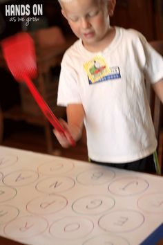 Find the Letter & Swat It! Active Way for Learning Letters! Could do this with sight words too!