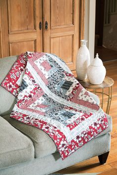The appealing combination of red, black, and gray makes this Log Cabin design pop! Piece twelve easy blocks, and you're almost done. Digital pattern and quilt kit and sizing options available! Look for Topsy Turvy in Easy Quilts Fall '14.