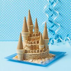 Sandcastle Cake. Easy fun with vanilla wafers, jumbo and small ice cream cups, sugar cones and graham crackers. http://tinyurl.com/3bv9wow  #Cake #Sand_Castle _Cake #Castle_Cake #familyfun