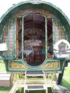 gypsy wagon at the Stow Fair in the UK - love the bird cage on the back.