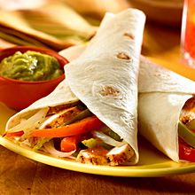 For an outdoor meal that's fun for everyone, serve up a sizzling batch of Grilled Chicken Fajitas!