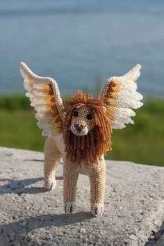 She provides a tutorial at http://venecia.su/about/ideas/5094/ An amazing sculpture.  It's done on an armature. winged lion sphinx - by Simba_Red