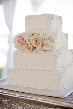 Tradition meets style when it comes to this pretty, off-white, square cake.