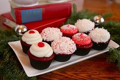 simple and classy red velvet christmas cupcakes with shredded coconut, crushed candy canes and red candies.