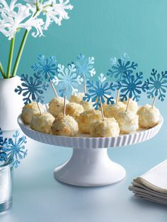 """Use snowflake toothpicks to dress up your hors d'ouvres, just like these coconut """"snowballs."""" So fun!"""