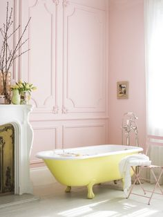 blush pink walls and yellow clawfoot tub. we'll take it.