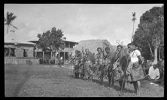Group of men lined up in ritual activity. Creator/Contributor: Lambert, Sylvester Maxwell, 1882-1947, Photographer Date:between 1919 and 1939 Contributing Institution: UC San Diego, Mandeville Special Collections Library