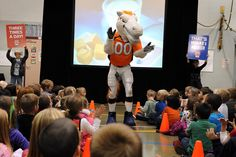 """Denver Broncos mascot Miles revs up Springs Ranch Elementary School students Nov. 12 during a """"Fuel Up to Play 60"""" event in Falcon School District 49. Throughout the 2012-2013 school year, numerous school events will encourage students to make healthy food choices and commit to 60 minutes of exercise every day. Fuel Up to Play 60, a program founded by the National Dairy Council and NFL, empowers students to make healthy dietary choices and lead active lifestyles."""