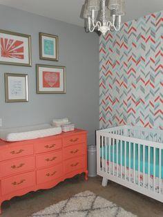 I like that printed wall!! Adorable Coral, Aqua and Grey Nursery | Herringbone Shuffle Stencil | Royal Design Studio